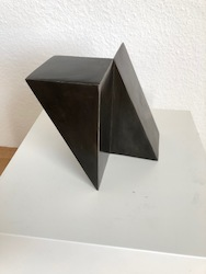 TWO QUATER OF A CUBE DIAGONALLY CUT IN HALF